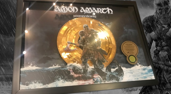 "Amon Amarth celebrate ""Week of Gold"", earns Gold certification in Germany for 2016's 'Jomsviking'; launches video for ""Fafner's Gold"""
